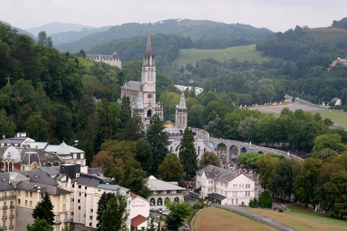 Lourdes, France.  in 1858 a peasant girl had visions of the Virgin Mary here, and the place subsequently became an important site of pilgrimage, in particular for those suffering from diseases that have no cure, for Lourdes is most famous for its number of miraculous healings (thousands of them).